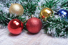 Christmas decoration isolated white. Red and golden gift boxes with three  ball,  floral ornament. Top view. Square composition. Royalty Free Stock Image