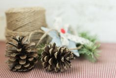 Christmas decoration. Jute,cones,star on vintage background Royalty Free Stock Photography
