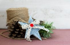 Christmas decoration. Jute,cones,star on vintage background Royalty Free Stock Photo
