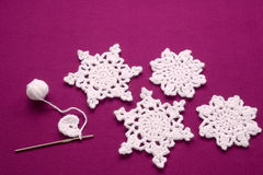 Christmas decoration knitted snowflakes Royalty Free Stock Images
