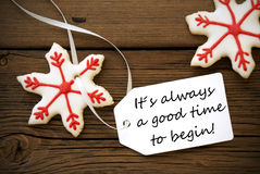 Christmas Decoration With Label With Life Quote On It. Red Christmas Stars Cookie With White Label With Life Quote Saying It Is Always A Good Time To Begin On royalty free stock photo