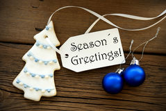 Christmas Decoration with Label with Seasons Greetings on it. Blue and White Christmas Decoration with a Label on which stands Seasons Greetings, Winter or Stock Photography