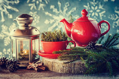 Christmas decoration: lantern, tea kettle and cup with spruce twigs Royalty Free Stock Photography