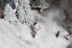 Christmas decoration large decoration toy. People make a snowman in the open space near the forest Royalty Free Stock Photo