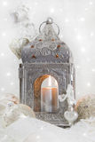 Christmas decoration with a latern in white and silver for a chr Royalty Free Stock Photography