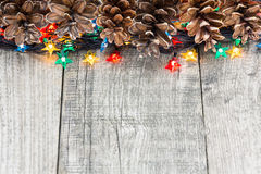 Christmas decoration with lights and cones Royalty Free Stock Photo