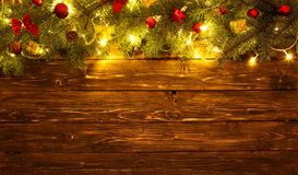 Christmas decoration and christmas lights frame on wooden background.  stock photo