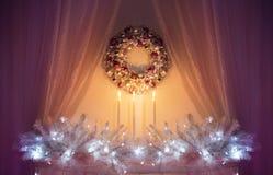 Christmas Decoration Lights, Xmas Decor Tree Branch, Wreath Candles Stock Photo