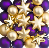 Christmas decoration. Lila and golden baubles, balls, stars Royalty Free Stock Image