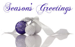 Christmas decoration lilac and silver balls with r. Ibbon on white with reflection stock images