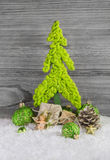 Christmas decoration with a lime green handmade tree, presents, Stock Images