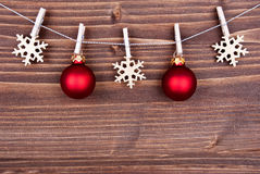 Christmas Decoration on a Line on Wood Royalty Free Stock Image