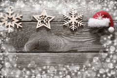 Christmas decoration with little red hat on wooden backgroun royalty free stock photo