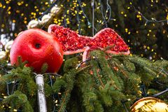 Christmas decoration made of papier mache in the form of an apple on a Christmas tree on the street of Prague royalty free stock image
