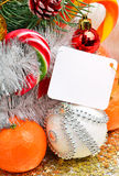 Christmas decoration, mandarines, pine twig, lollipops, sweets Stock Image