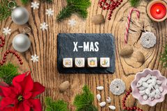 Christmas decoration and the message `X-MAS` stock images