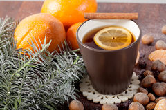 Christmas decoration and mug of tea Royalty Free Stock Photos