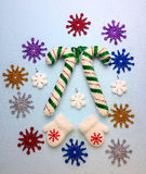 Christmas decoration: multicolored snowflakes and white mittens. Stock Image