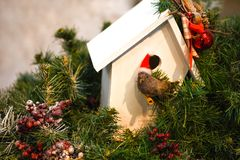 Christmas decoration with a nest in a green Christmas tree. Christmas decoration with a nest in a green tree royalty free stock photography