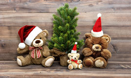 Christmas decoration with nostalgic toys Teddy Bear family. Vintage style toned picture royalty free stock image