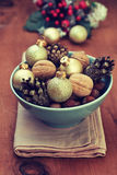 Christmas decoration with nuts, cones, Christmas balls Royalty Free Stock Photos
