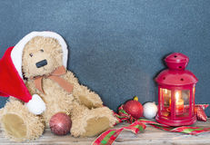 Christmas decoration with old bear, balls and lamp royalty free stock photos