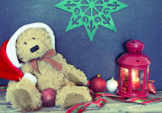 Christmas decoration with old bear, balls and lamp Royalty Free Stock Image