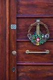Christmas decoration on an old door at downtown of Cagliari, Sardinia Stock Image