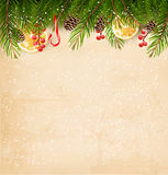 Christmas decoration on old paper background. Stock Photos