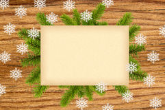 Christmas decoration with old paper and fir tree branch on woode. N table background Stock Image