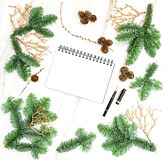 Christmas decoration open book Pine branches golden ornaments. Christmas decoration and open book on marble stone texture. Pine branches with golden ornaments Stock Photos