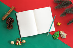Christmas decoration with opened notebook and fir leaves. Holiday concept. Stock Images