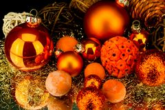 Christmas decoration in orange on black Stock Photography