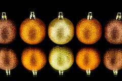 Christmas decoration in orange on black Royalty Free Stock Photo