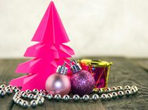 Christmas decorations, silver and pink. Christmas decoration with origami Christmas tree pink and bright pink balls and silver beads Stock Photo
