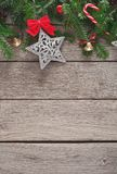 Christmas decoration, ornaments and garland frame background. Xmas decoration border background. Fir tree branches border with star, candy canes and bells top royalty free stock photo