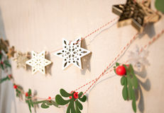 Christmas decoration. Christmas ornaments hang on the wall in the evening light Stock Images