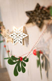 Christmas decoration. Christmas ornaments hang on the wall in the evening light Stock Photos