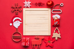 Christmas decoration and ornaments isolated on red Stock Photos