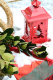 Christmas decoration outside with a red lantern and a green twig Stock Photo
