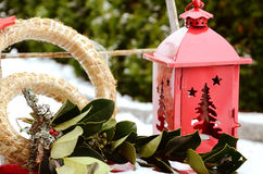 Christmas decoration outside with a red lantern and a green twig Royalty Free Stock Photography
