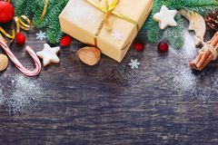 Christmas decoration over dark wooden background, top view. Hori Stock Photography