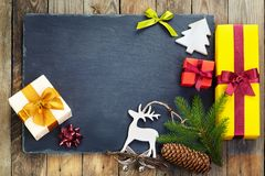 Christmas decoration over old wooden background. Royalty Free Stock Images