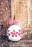 Christmas decoration over wooden background with snowflakes. Vin Stock Photography
