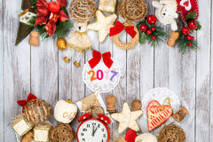 Christmas decoration over wooden background. Winter holidays concept. 2017 colorful numbers. Royalty Free Stock Photo