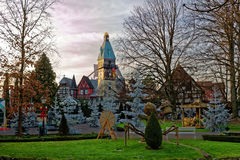 Christmas decoration in park landscape. Evening mood in Europa Park Rust, Germany, at the German themed village in Christmas season Stock Image