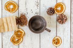 Christmas decoration. Photography Christmas background and dried oranges decoration with cone and hot cup of tea Stock Photos