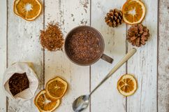 Christmas decoration. Photography Christmas background and dried oranges decoration with cone and hot cup of tea Royalty Free Stock Photos