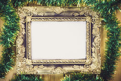 Christmas decoration with picture frame on wooden background. Wi Royalty Free Stock Image