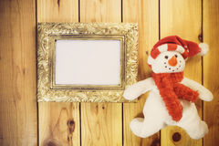 Christmas decoration with picture frame on wooden background. Wi Royalty Free Stock Photography